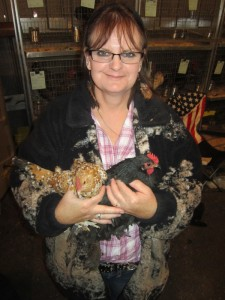 Marilyn Wheeler hold a Mille Fleur, left, and a Black Cochin, for her daughter Ashley at the show. (Ernie Over photo)