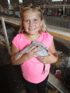 "Shatyl Denevan of Lander with her one month old slate gray turkey hen, ""at least I'm pretty sure it's a hen,"" she said. (Ernie Over photo)"