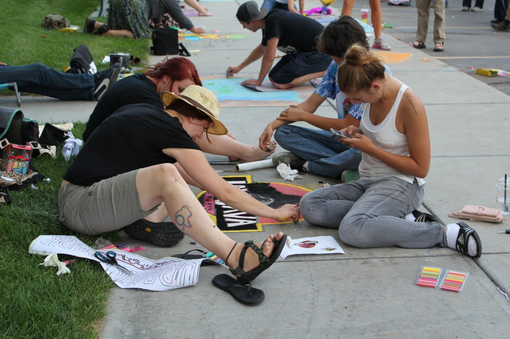 A team works on their art at Wednesday night's Chalk the Walk at the Riverton Branch Library. See the winners below. (Riverton Branch Library photo)