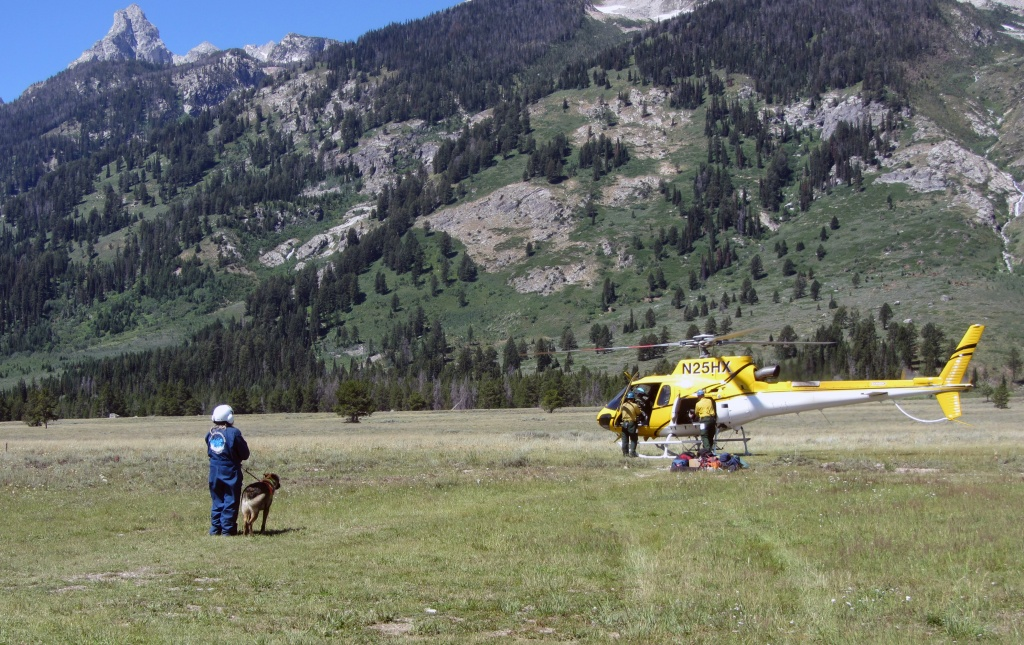 Park Ranger Janet Wilts with her search dog Chaco get ready to board Teton Interagency helicopter during Cornyn search and rescue mission, July 22, 2014. Photo credit:  Andrew White, NPS  (Photo by Andrew White, NPS)