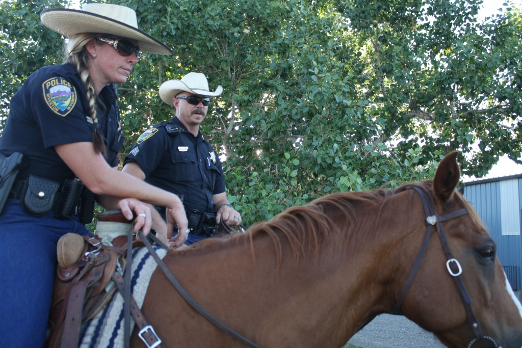 The RPD's Sara Lowe and Charlie Marshall were on horseback during the 2013 Riverwalk.  (file photo)