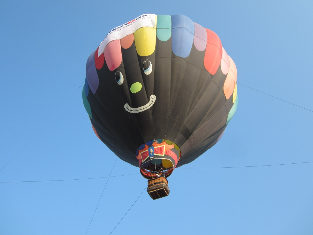 "Gayle McCoy's ""Misbehavin'"" hot air balloon gave tethered rides to residents at the Wyoming Life Resource Center in Lander this morning. The balloon is in Fremont County for the weekend Riverton Rendezvous Balloon Rally tomorrow and Sunday. Photo provided by Patrice Chesmore."