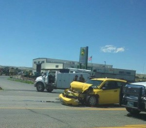 The yellow vehicle rear-ended the truck in the foreground at the entrance to Stotz Equipment on north highway 789 out of Riverton. (Photo by Ray Oliver)