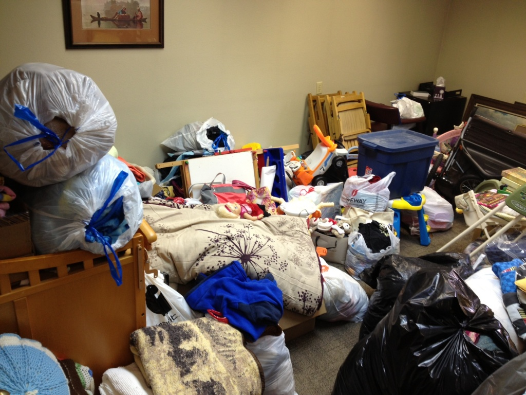 One of two rooms full of donated household and clothing for the Van Dijk family. (Ernie Over photo)