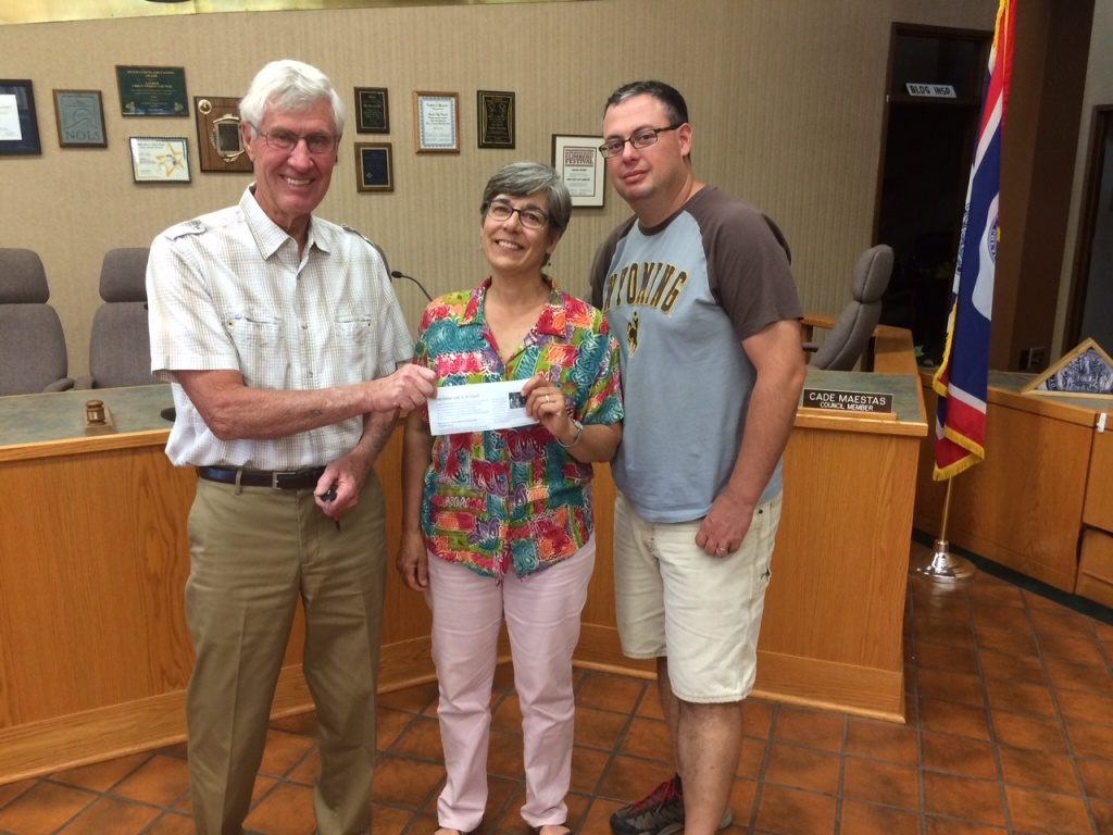 Council President Nancy Pieropan presents her check to Mayor Mick Wolfe and Councilman Cade Maestas. Photo provided.