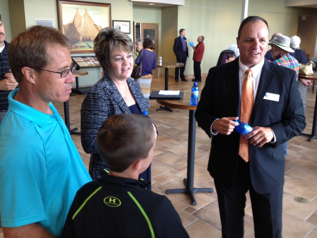 Dr. Chris Valdez chatted with CWC Riverton Trustee Nicole Schoening, her husband Scott and son Cameron at Wednesday's event. (Ernie Over photo)