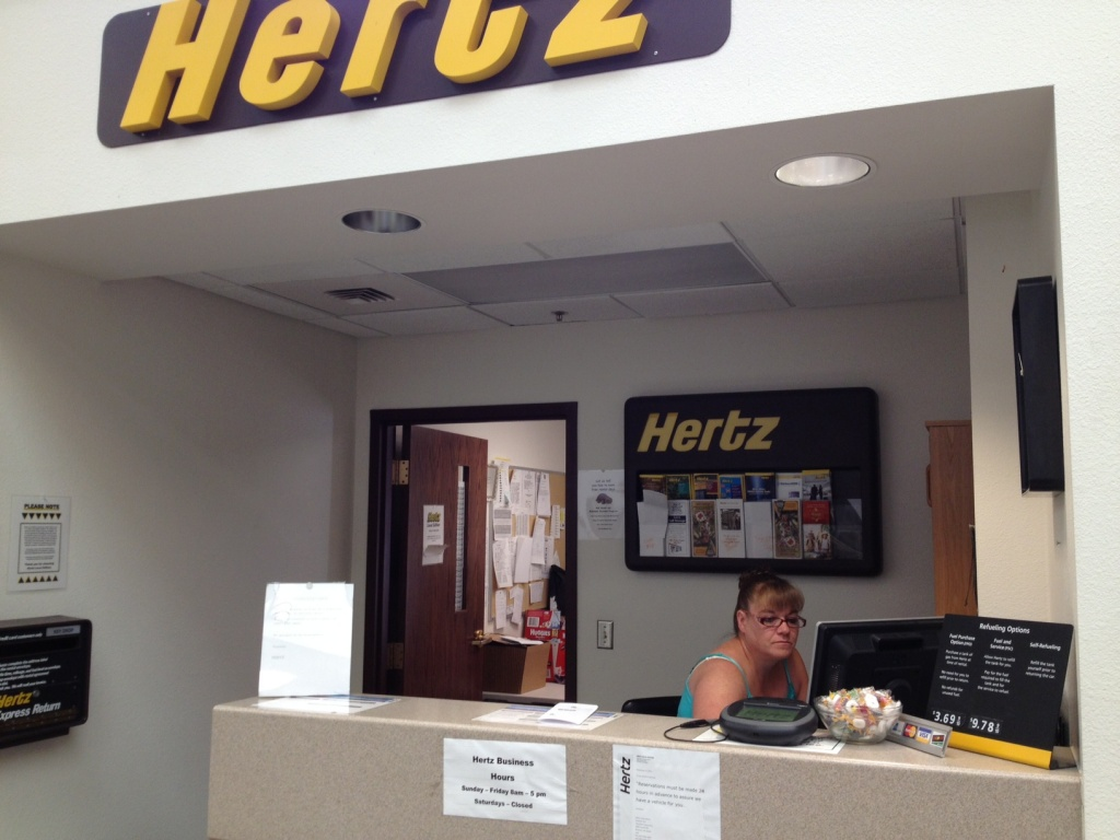 Tina Chancellor at the Hertz Counter at Riverton Regional Airport said air service reliability problems has hurt her rental car business. (Ernie Over photo)
