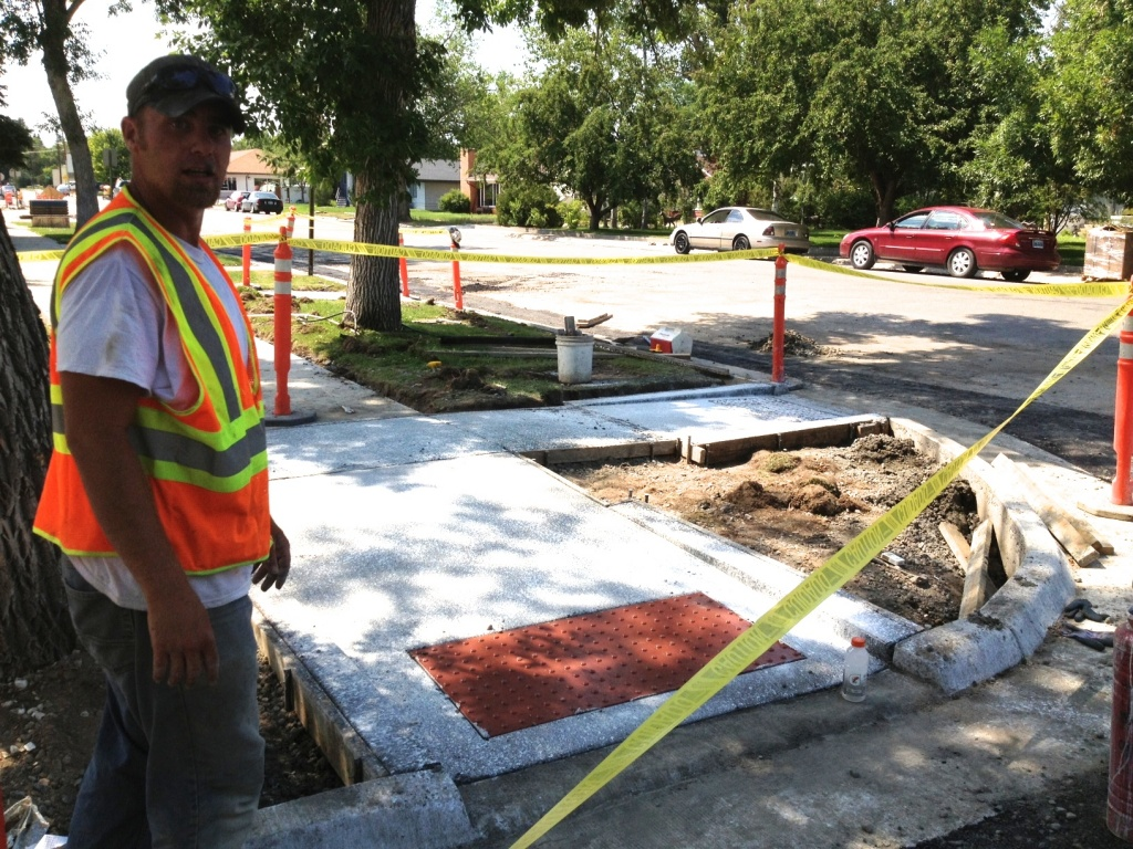 Concrete work underway this week includes finishing of handicap accessible sidewalk ramps on East Park, as shown here by Marcel Oesterholz.