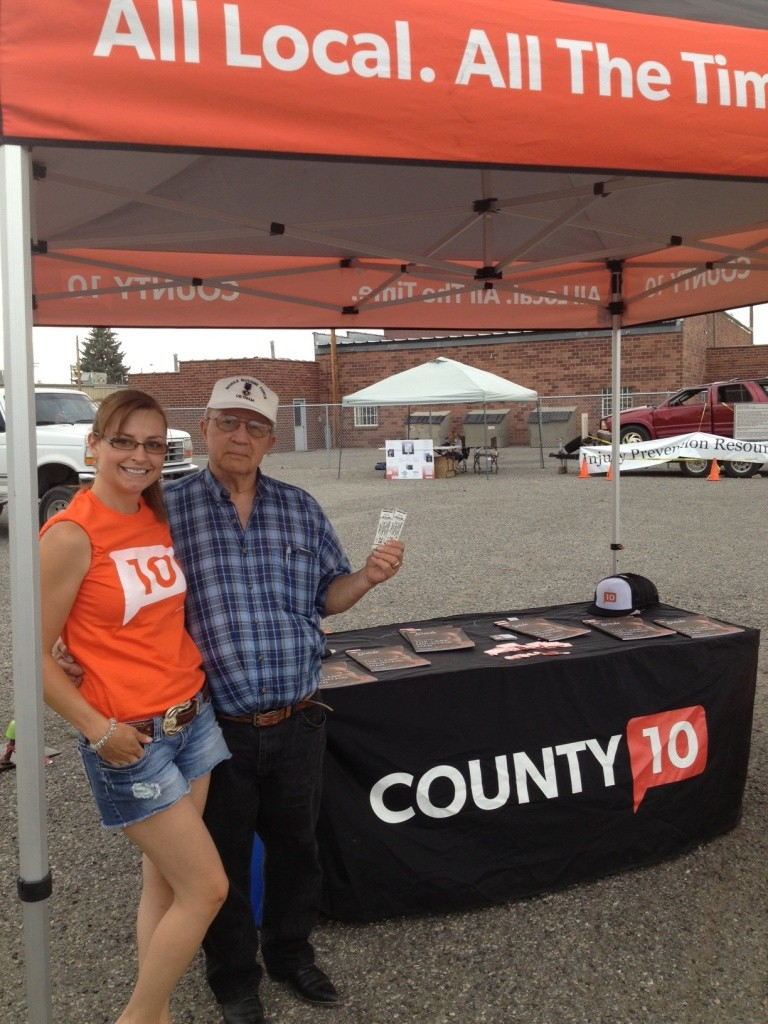 Gary Weisz of Shoshoni with Ashlee Kintzler at the County10.com booth on the Fairgrounds Midway. (Ernie Over photo)