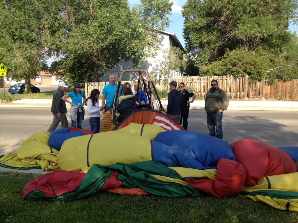 The envelope of the balloon was singed and a rope was burned when it brushed a power line during the landing. No one was injured. (Ernie Over photo)