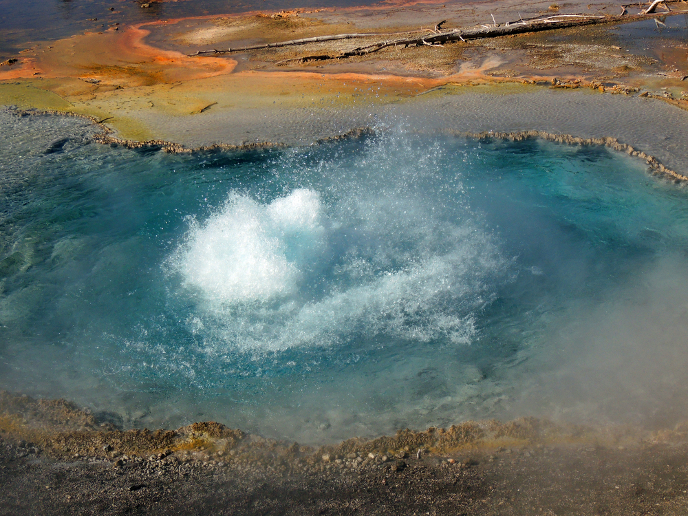 A hot spring off Firehole Lake Drive in Yellowstone. Photo by Nina B/Shutterstock.