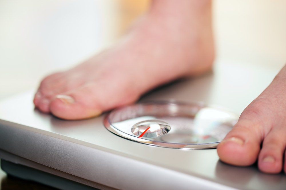 Bathroom scale image by Kzenon/Shutterstock.com.