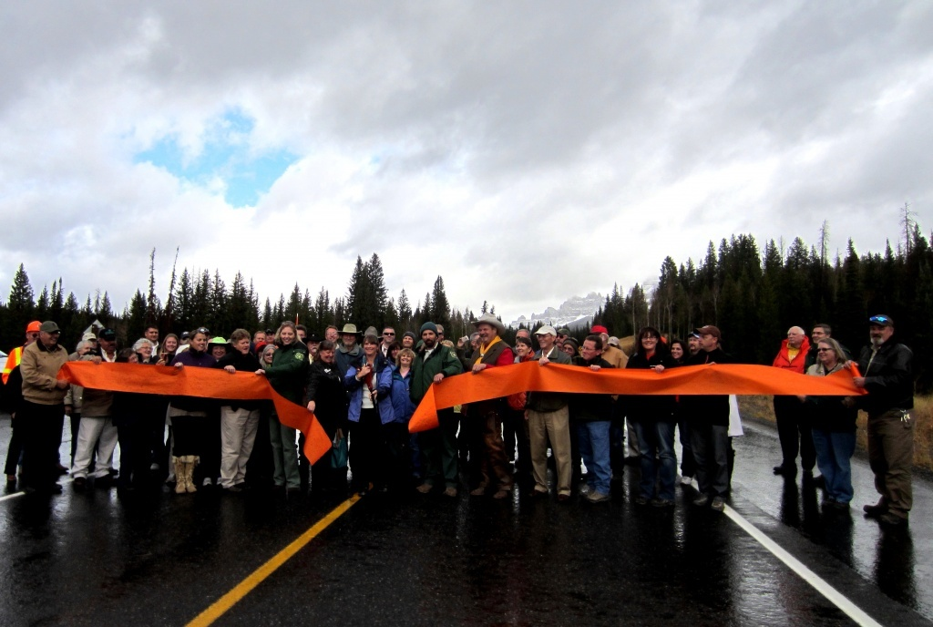 A large group of celebrants are pictured at the October 2012 ribbon cutting ceremony dedicating the newly rebuilt highway over Togwotee Pass. (File Photo)