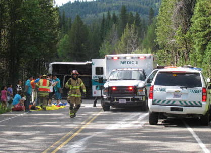 In this photo provided by Grand Teton National Park, a tour bus carrying Asian travelers flipped on its side Thursday. (GTNP_