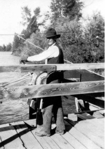 Bill Menor at Menor's Ferry across the Snake River in the late 1800s, early 1900s. (GTNP)