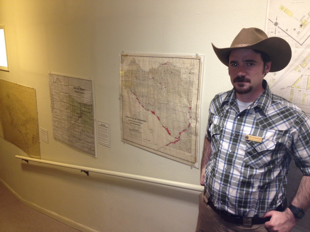 The Visitor Services Coordinator at the Riverton Museum, Dr. Jackson Crawford, stood before a collection of local historic maps from the museum's collection. (Ernie Over photo)