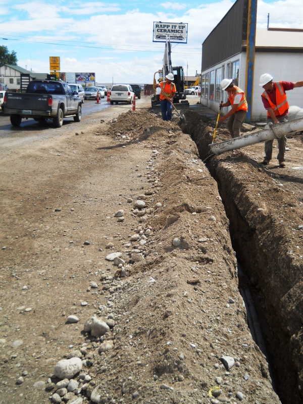 Photograph of flowable fill concrete being poured this week in a South Federal Boulevard trench containing street lighting conduit and wiring. Provided by Cody Beers.