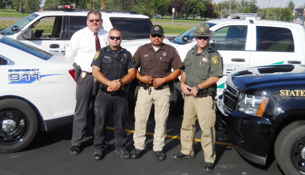 "Participating in the ""Drive Hammered, Get Slammered!"" photo shoot signifying Fremont County's unified drunk-driving enforcement efforts are, from left, Lander Police Chief Jim Carey, Riverton Police Department Officer Anthony Armstrong, Fremont County Deputy Sheriff Arnie Zertuche, and Wyoming Highway Patrol Trooper Robert Henry."