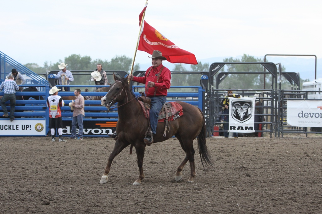 Military veteran Jack Darnall, 88, was honored during Military Night at the Wind River PRCA Rodeo Roundup Monday night. Darnell carried the flag of the U.S. Marine Corps into the arena. Jack is a a World War II Imo Jima Survivor. 2014 also marks the 50th year of the Vietnam War, so Fremont County's Vietnam Vets were honored that night. (Alan Sinner photo)