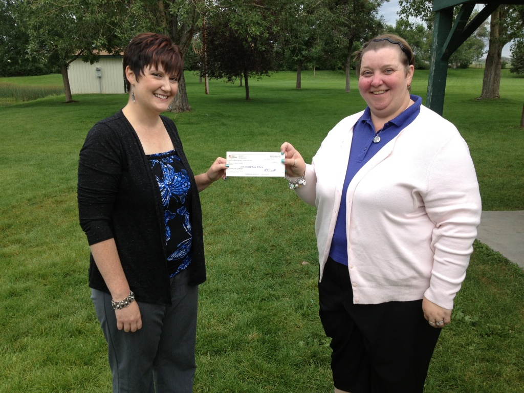 Riverton Jaycees President Angie Lehto, left,  presented Immediate National Jaycees Past President Chrystal Ramsay-Dyess with a check for $1,624.42 for the Nothing But Nets campaign. The presentation was made at Riverton's Jaycee Park. (Ernie Over photo)