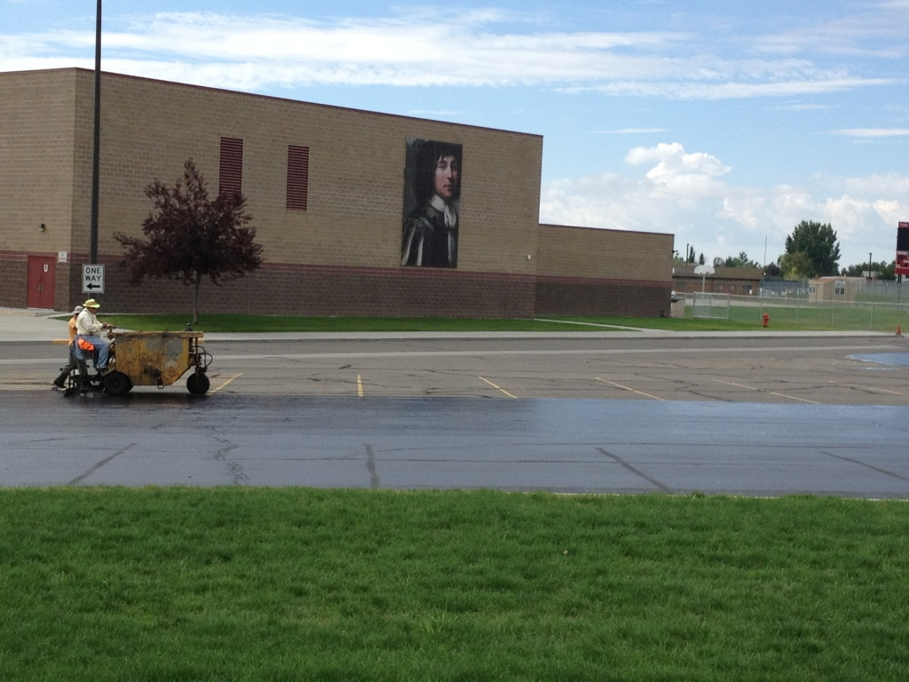 A sealant is applied to the parking lot at the Riverton Middle School in preparation for the beginning of the  school year later this month. (Ernie Over photo)