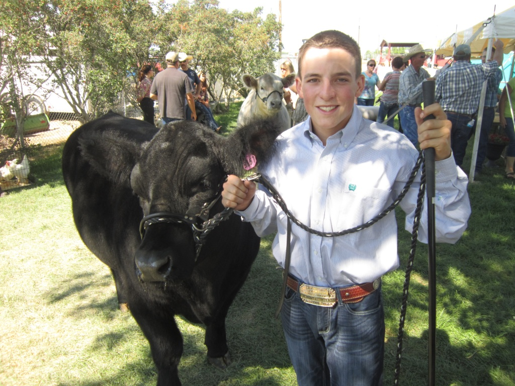 "Mark McConnell with his Grand Champion Market Beef ""Reggie""  (Ernie Over photo)"