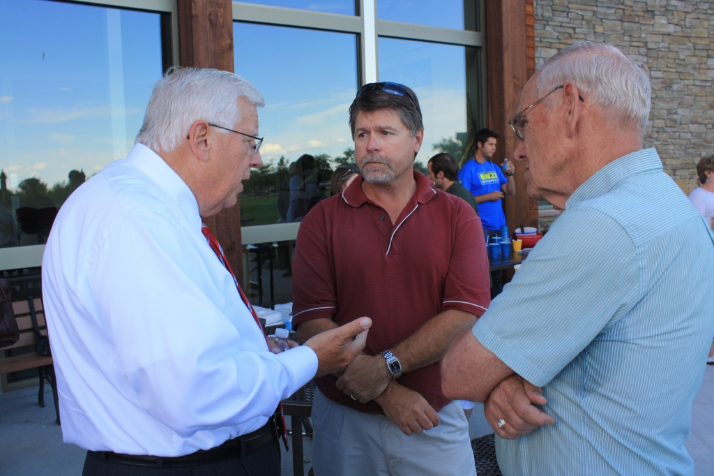 U.S. Senator Mike Enzi talked with County Commissioner Travis Becker and Riverton Mayor Ron Warpness before Thursday night's debate at Central Wyoming College. (Ernie Over photo)