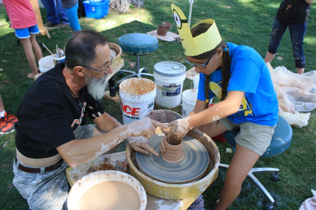 Max Spencer gave pointers to Emily Sheridan at the potters wheel.