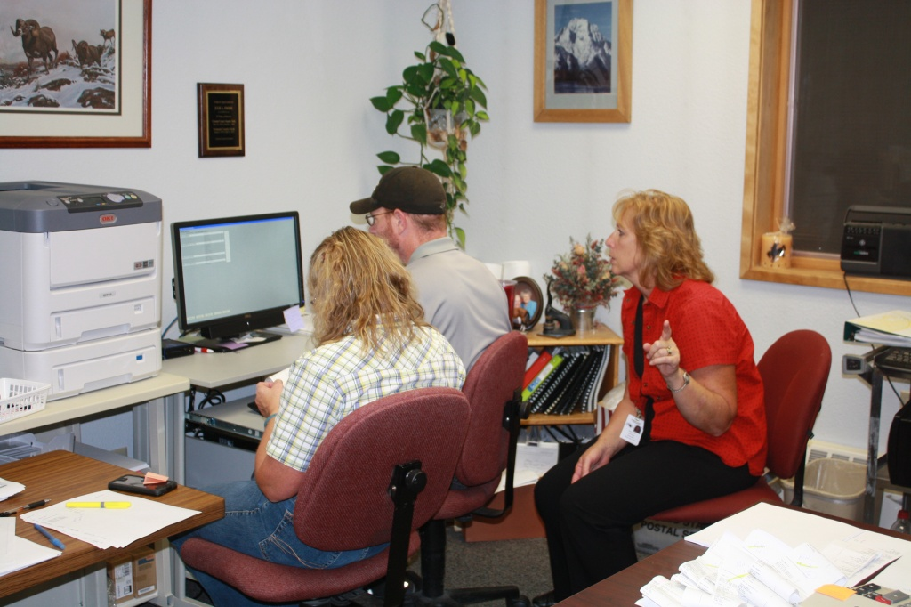County Clerk Julie Freese looked over the shoulders of IT techs Joni Miller and Chris Worthey as the last absentee ballot was entered in the system last Tuesday night.  (Ernie Over photo)