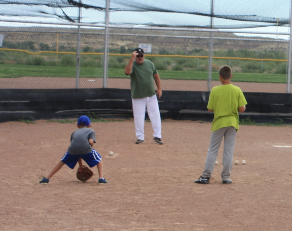 RPD Chief Mike Broadhead gave the youngsters some fielding practice on the first morning on the baseball camp. (Ernie Over photo)