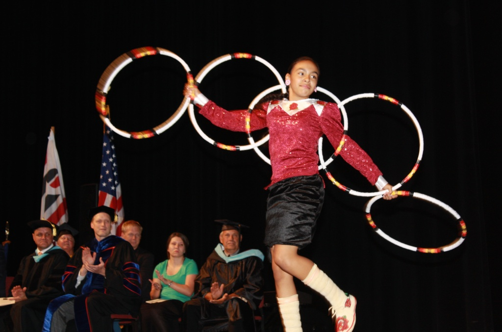 Fort Washakie School Sixth Grader Jaden Ferris entertained the Convocation assembly with a Hoop Dance. New CWC President Dr. Chris Valdez, seated, applauds at far left next to Dr. Jason Wood. (Ernie Over photo)