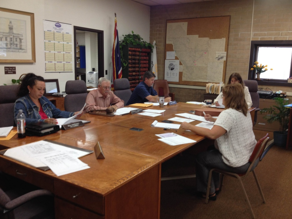 Fremont County Assessor Tara Berg, right, meets with the Fremont County Commission.