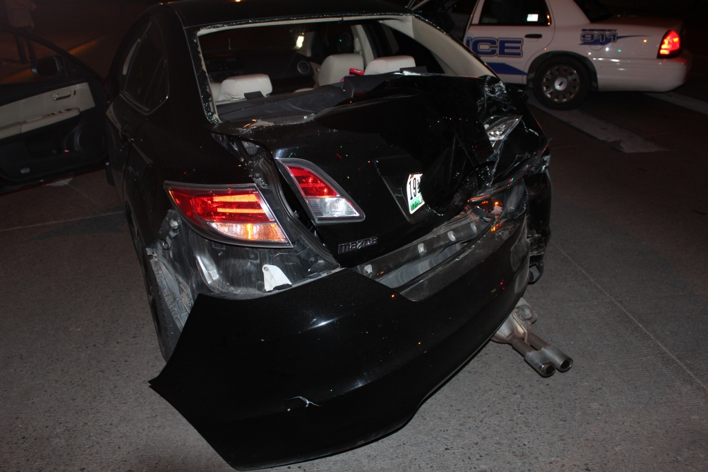 This Mazda was struck from behind by a white Ford pickup truck that fled the scene. (LPD)