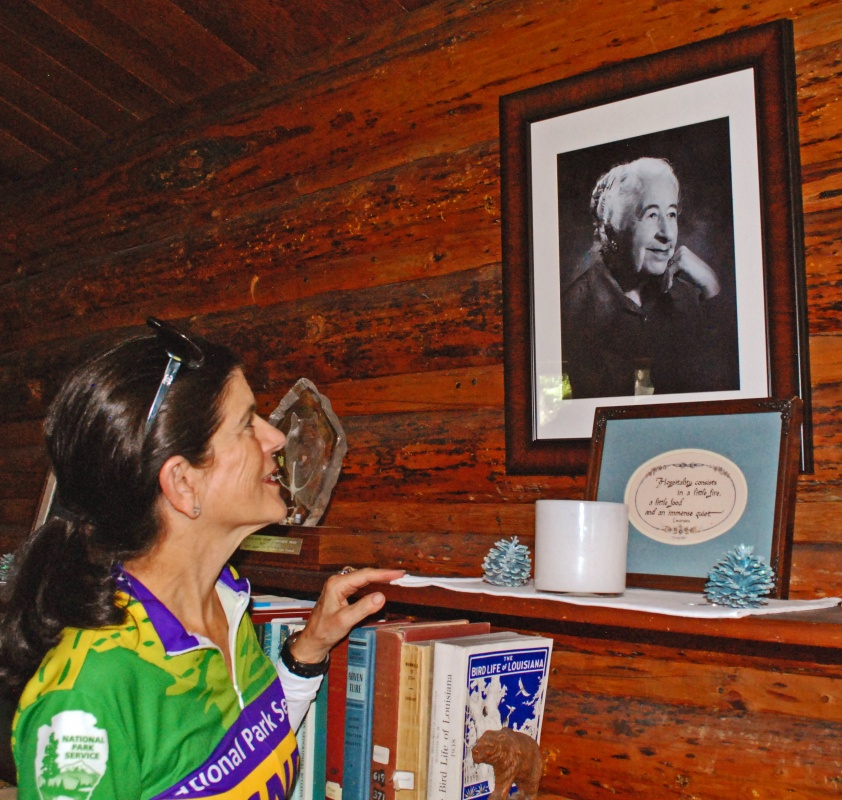 Luci Baines Johnson gazes at a photo of Mardy Murie, the Grandmother of Conservation, during her visit to the Murie Ranch in Grand Teton National Park. Luci Johnson served as keynote speaker for a celebration of the 50th Anniversary of the Wilderness Act of 1964. (Jackie Skaggs, NPS)