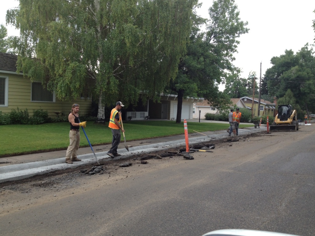 Patching work around a new curb and gutter is underway along North 1st street. (Ernie Over photo)