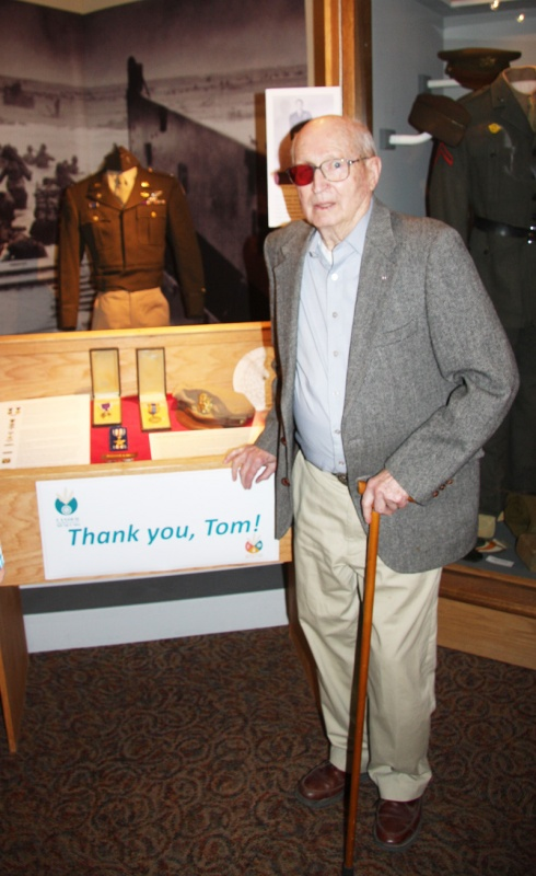 Tom Bell stood in front of a new exhibit featuring his memorabilia from WWII when he served in the Army Air Corps. (Fremont County Museum photo)