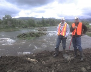 In 2010, Cale and others spent 11 days fighting flooding that threatened Lander.  He is shown here with Richard Garrett by a new channel cut by the Popo Agie through an open field above town.  The flooding was turned back to the river before it reached Lander
