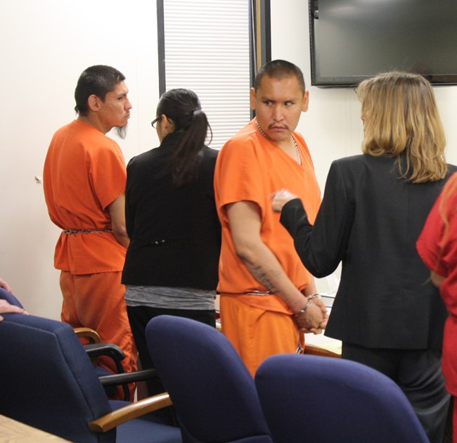 Defendants Craig C'Bearing, left, and George Littlethunder III, right, stood as proceedings began in Ninth District Circuit Court in Riverton earlier this year.