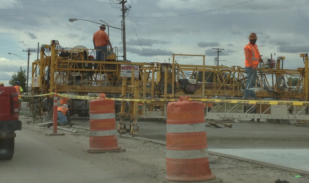 Crews from Reiman Corp. continue to pour concrete on the west side of South Federal Boulevard. (Ernie Over photo)