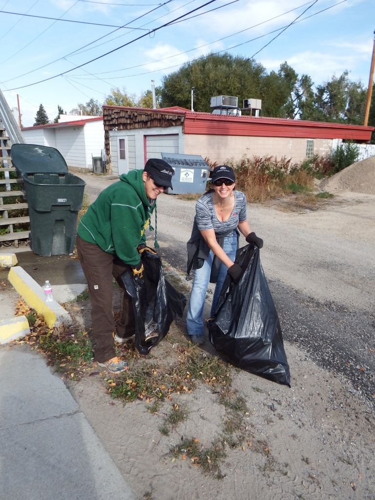 Carol King and Susan Weideman picked up debris on the north side alleyway between 5th and 6th. (Ernie Over photo)