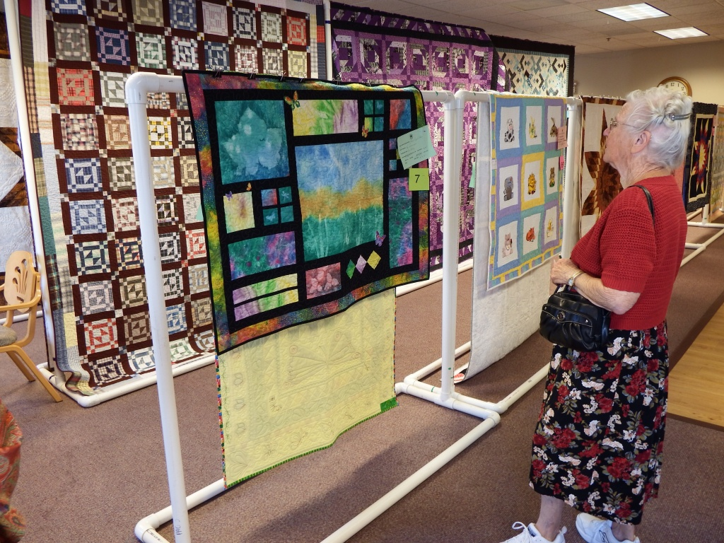 Donabelle Leonhardt of Riverton admired this small and intricate quilt at today's show. (Ernie Over photo)
