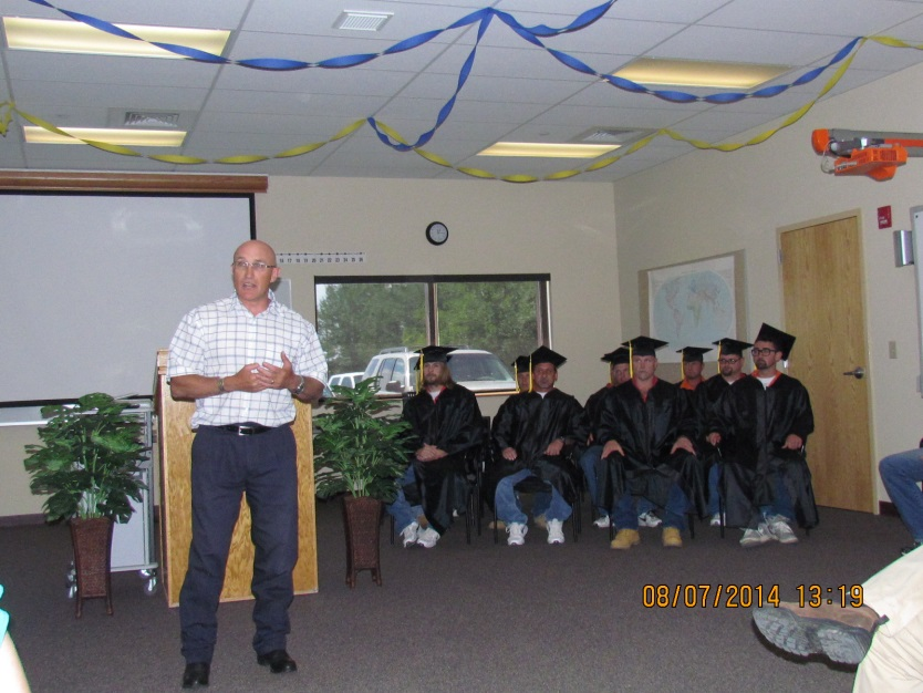 Fremont County School District #25 Special Services and Alternative School Director Dallas Meyers encouraged the graduates at their GED ceremony. (WHF photo)