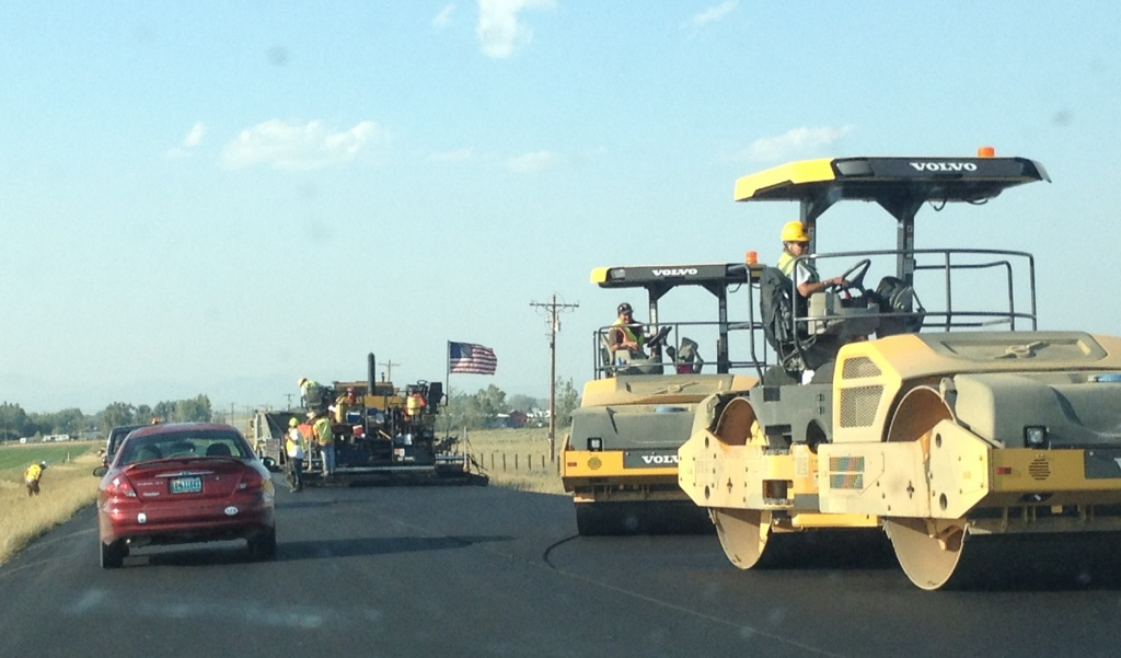 A paving crew from HK Contractors of Idaho is working Saturday on the 8 Mile Road resurfacing project. (Ernie Over photo)