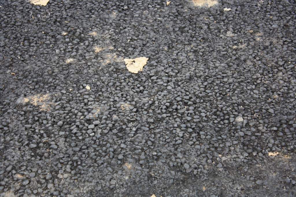 The new parking lot at the Lander Community and Convention Center was laid down without heavy roller compaction, calling into question the long term stability of the work. (file photo)