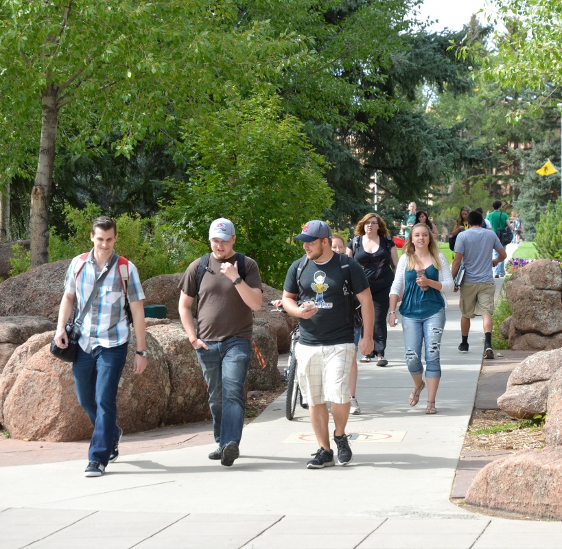 Students emerge from Prexy's Pasture in Simpson Plaza at the University of Wyoming Thursday, the second day of the fall 2014 semester. UW's first-day enrollment was up 95 students from last fall, with an increase of 174 students on the Laramie campus. (UW Photo)