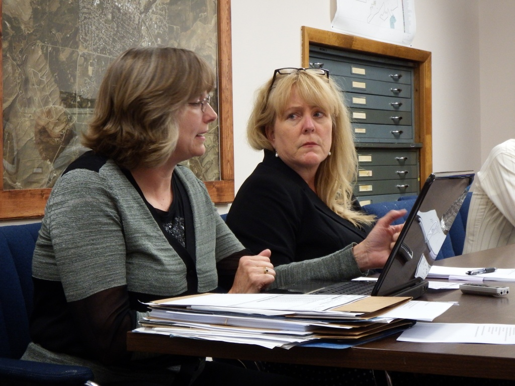 City Clerk Robin Griffin, left, and City Treasurer Charri Lara discussed the need for a more clearly defined policy dealing with water bill discount requests. (Ernie Over photo)