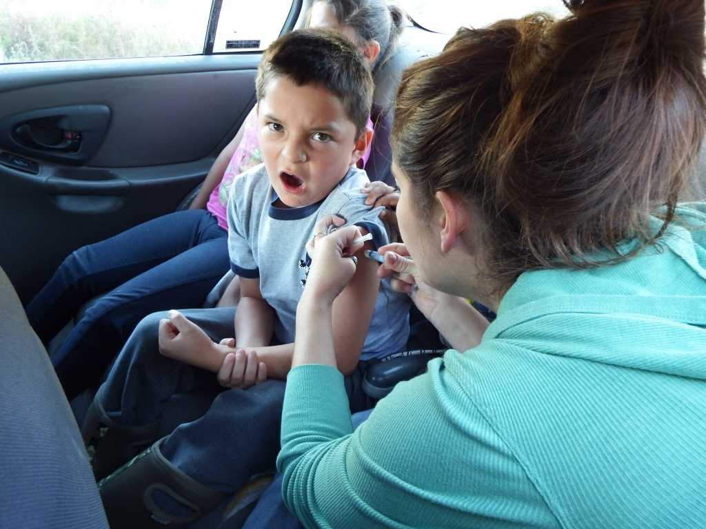Landon Nez reacted to getting his flu shot during a drive-through clinic last fall. The State Health Officer is urging all parents to be current with their children's vaccinations as a measles outbreak is underway in neighboring states.