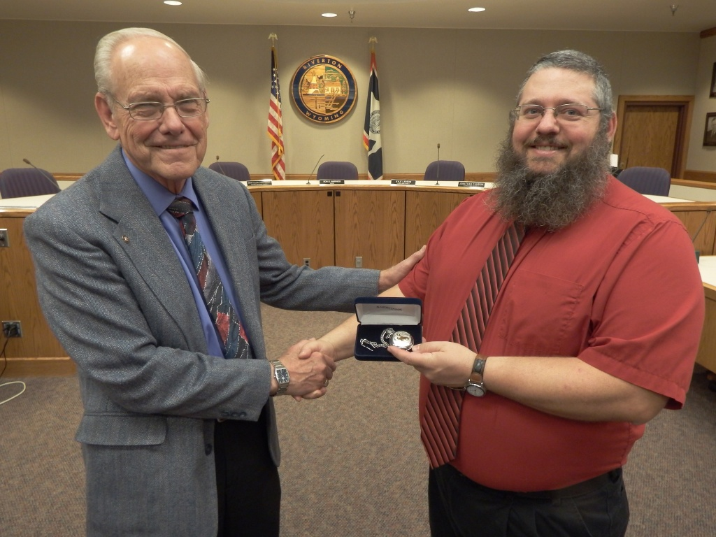 Todd Smith received a silver watch for his service on the city council from Mayor Ron Warpness.