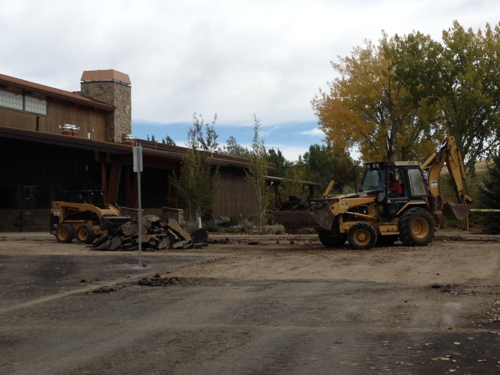 Asphalt was being removed from the parking lot after lunch Monday. (Ernie Over photo)