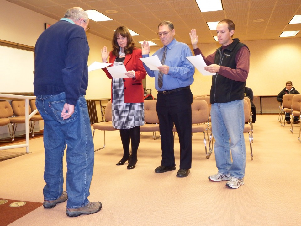 Attorney Joel Vincent administered the oath of office to Sandy Barton, Larry Choinard and Kevin Tippets at Tuesday's District 25 board meeting.